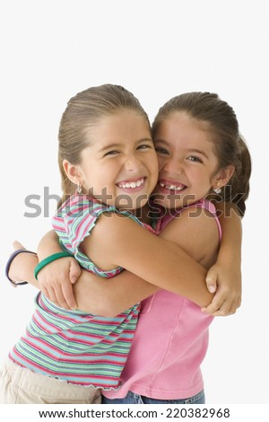 Portrait of two girls hugging - stock photo