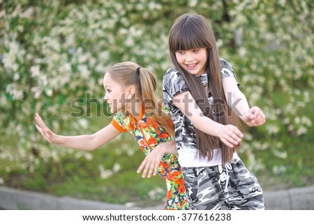portrait of two girls of girlfriends on a summer nature - stock photo