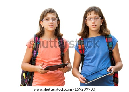 Portrait of two handicapped twin sisters holding digital tablets.Isolated on white background. - stock photo
