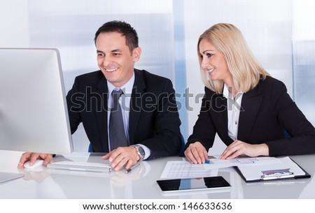 Portrait Of Two Happy Business Colleagues At Office Working Together