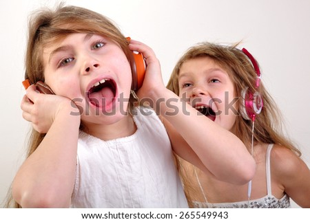 portrait of two happy children listening to music