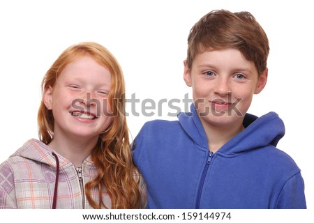 Portrait of two happy children on white background - stock photo