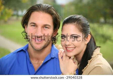 portrait of two happy couple with background park