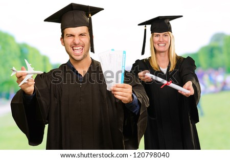 Portrait Of Two Happy Graduate Students, Outdoors - stock photo
