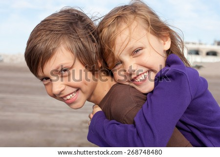 portrait of two happy little friends outdoors - stock photo