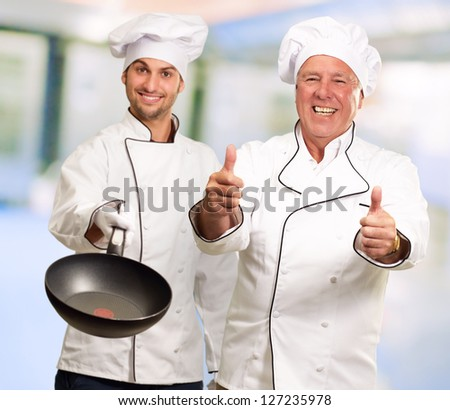 Portrait Of Two Happy Male Chef, Indoors - stock photo