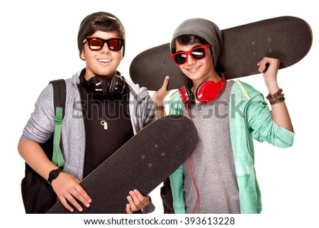 Portrait of two happy teen boys with skateboards isolated on white background, cool trendy look, active urban lifestyle of youth - stock photo