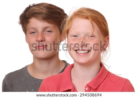 Portrait of two happy teenagers on white background - stock photo