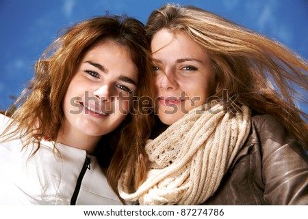 Portrait of two happy young women looking at camera