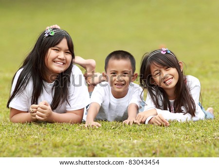 portrait of two kids family outdoor smiling
