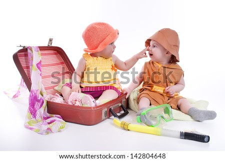 portrait of two kids with a large suitcase - stock photo