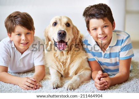 Portrait of two little boys and a dog - stock photo