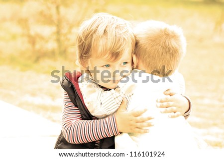 Portrait of two little brothers. Friendship and support - stock photo