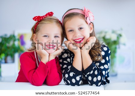 portrait of two little cute girls fashioners