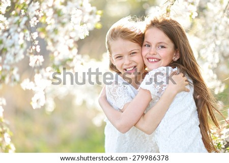 Portrait of two little girls girlfriends spring