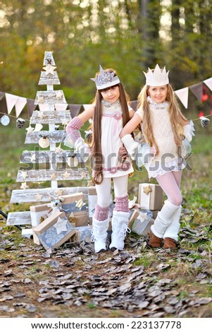 portrait of two  little  girls in a Christmas style - stock photo
