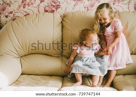 portrait of two little girls in pink dresses, sisters