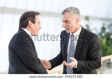 Portrait of  two mature businessman at office - stock photo