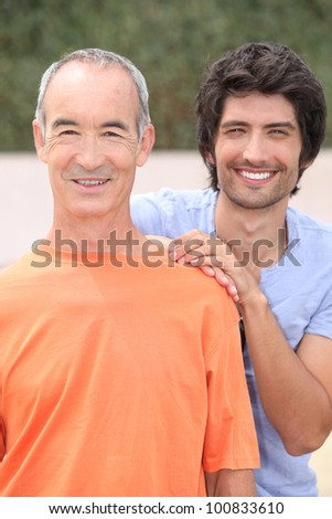 Portrait of two men outdoors - stock photo