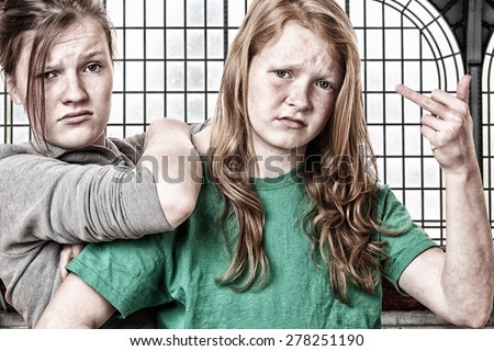 Portrait of two naughty girls  - stock photo