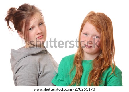 Portrait of two naughty girls on white background - stock photo