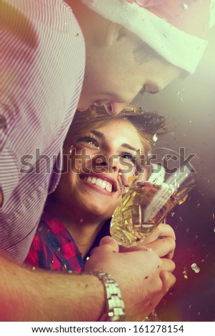 Portrait of two people in love on the new years eve party - stock photo