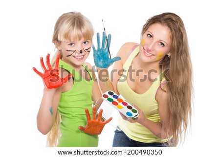 Portrait of two playful girls with comic makeup. Isolated on white - stock photo