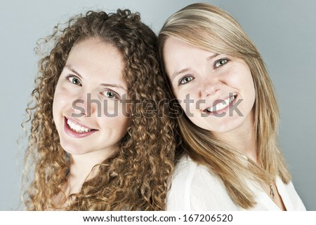 Portrait of two pretty caucasian young women - stock photo