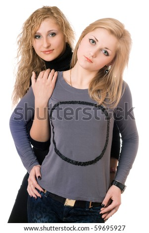 Portrait of two pretty young women. Isolated