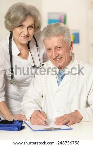 Portrait of two senior doctors - stock photo