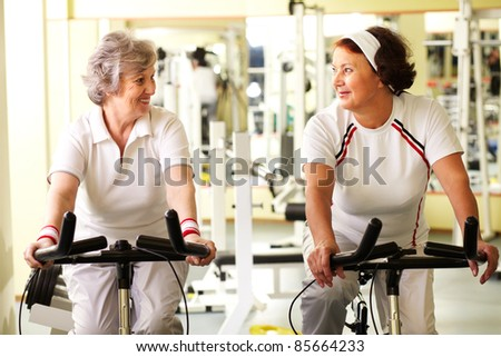 Portrait of two senior women in good form - stock photo