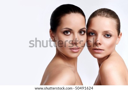 Portrait of two sensuality young beautiful girls - stock photo