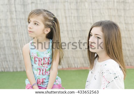 portrait of two sisters outdoors with natural light