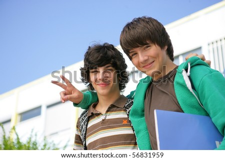 Portrait of two smiling boys with notebooks - stock photo