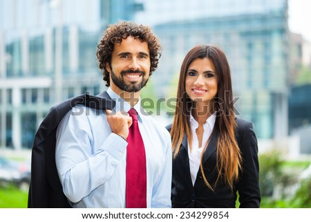 Portrait of two smiling business persons - stock photo