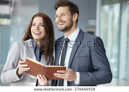 Portrait of two smiling business persons
