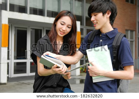Portrait of Two students at a campus - stock photo