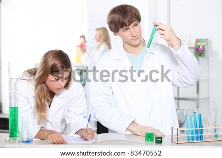 portrait of two students in a lab - stock photo
