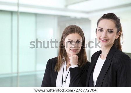 Portrait of two stylish Businesswomen. Caucasian brunette female model. - stock photo