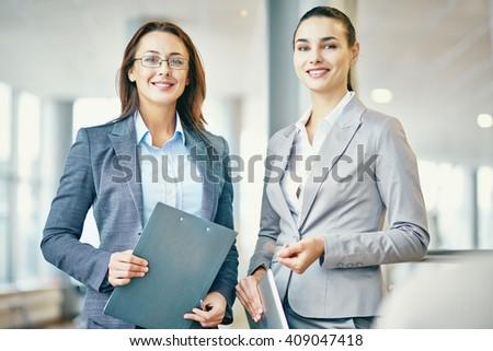 Portrait of two successful businesswomen - stock photo