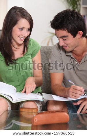 portrait of two teenagers studying