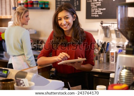 Portrait Of Two Women Running Coffee Shop Together - stock photo