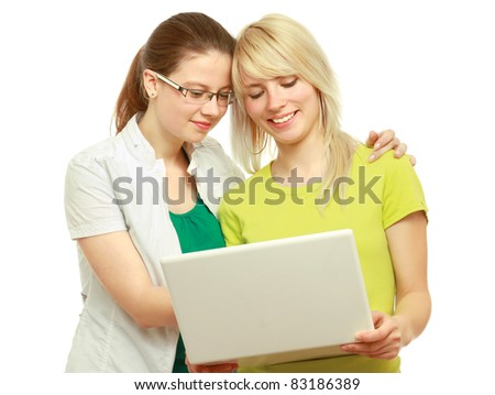 Portrait of two women viewing laptop isolated on white background.