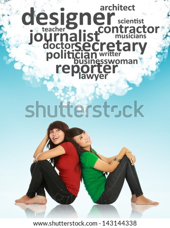 portrait of two young asian female looking up thinking of professions - stock photo