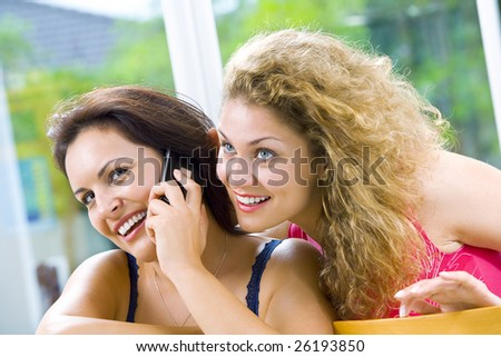 Portrait of two young attractive women in domestic environment