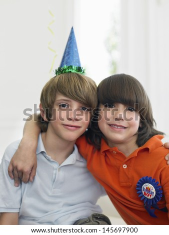 Portrait of two young boys at a birthday party - stock photo