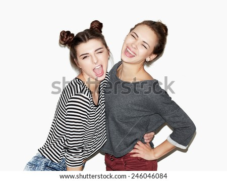Portrait of two young girl having fun and laughing. - stock photo