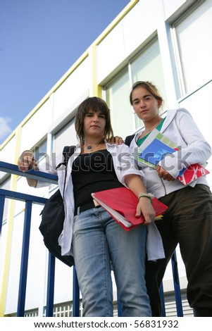 Portrait of two young girls with documents