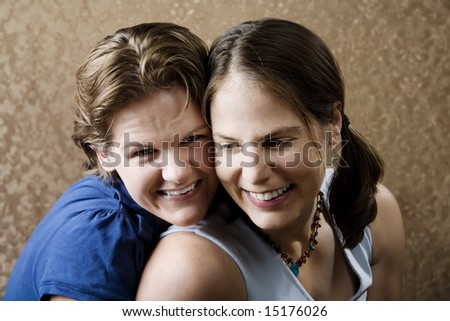 Portrait of Two Young Women Friends Laughing - stock photo