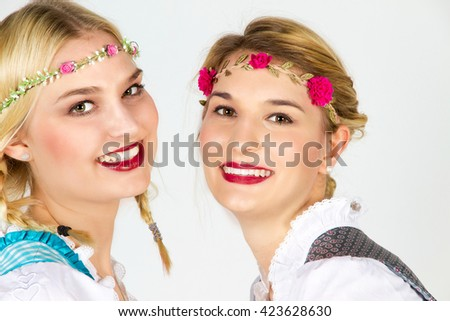 Portrait of two young women in dirndl - stock photo